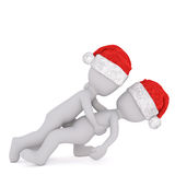 Two 3d toons in Santa hats wrestling. Side view of two 3d toon figures in Santa hats wrestling or embracing on white Royalty Free Stock Image