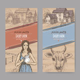Two dairy farm shop labels with farmhouse, milkmaid and cow. Royalty Free Stock Image