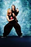 Two dancers. Modern teenage girls dancing hip-hop at studio Stock Images