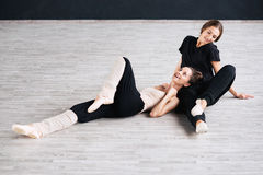 Two dancers friends practice in dance studio Stock Images