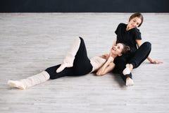 Two dancers friends practice in dance studio Stock Images