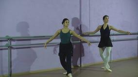 Two dancers friends practice in studio. Two dancers friends practice in classroom stock video