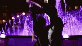 Two dancers in the light of beautiful night lights. Cool beautiful couple. stock video footage