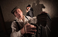 Two Dancers Near Bandoneon Player Stock Photo
