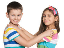 Two dancing kids. Portrait of two dancing smiling kids on the white background Stock Photo