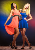 Two dancing women in dresses. Stock Photography