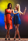 Two dancing women in dresses. Royalty Free Stock Photography