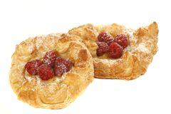Two danish pastries. Danish pastries with raspberries on a white background Stock Images