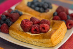 Two Danish Pastries With Raspberries and Blueberries Royalty Free Stock Photography