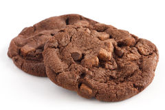 Two dark large chocolate chip cookies Royalty Free Stock Photos