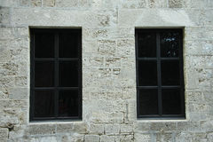 Two dark windows. On the wall of ancient castle in Rhodes Stock Photo