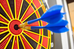 Two darts in bullseye of dartboard Royalty Free Stock Image