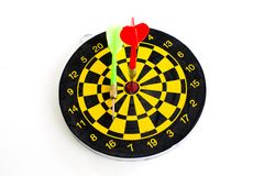 Two darts in center of target isolated on white Stock Photo