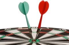 Two darts on  a dart board Royalty Free Stock Image
