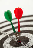 Two darts on a dartboard. Shallow depth of field shot of darts in bullseye on dartboard Stock Photos
