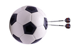 Two darts in football ball Royalty Free Stock Photography