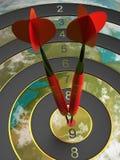 Two darts hitting the bullseye aim. concept of success 3d illustration Stock Image
