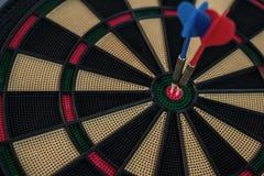 Two Darts On A Dart Board Stock Photo