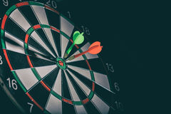 Two darts in the target center Stock Image