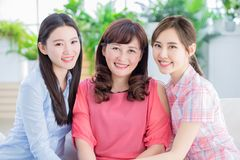 Two daughter with mother smile stock photography