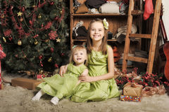 Two daughters in a green dress. At Christmas Royalty Free Stock Photography