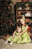 Two daughters in a green dress Stock Image