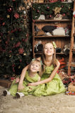Two daughters in a green dress Stock Photos