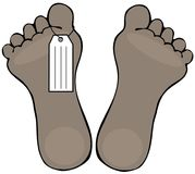 Two dead feet with a toe tag Royalty Free Stock Photography