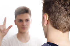 Two deaf-mute teenagers communicating Royalty Free Stock Image