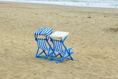 Two deck chairs on the beach at Sandown Stock Photo