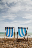 Two Deck Chairs on Brighton Beach, England Royalty Free Stock Photography