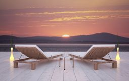 Two deck chairs on infinity terrace Stock Photography