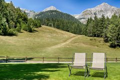 Two deck chairs on the meadow Stock Photo