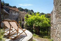 Two deck chairs in a patio. Sunny day in Italy stock image