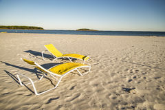 Two deck chairs on sandy beach Royalty Free Stock Photography