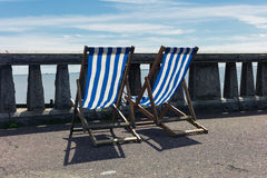 Two deck chairs by the seaside Stock Images