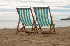 Two deck chairs. Deck chairs set up on swanage beach Royalty Free Stock Photo