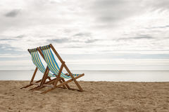 Two deck chairs. Deck chairs set up on swanage beach Royalty Free Stock Photos