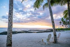 Two deck chairs at sunset on an empty beach at Lefaga, Matautu,. Two deck chairs on an empty beach at Lefaga, Matautu, Upolu Island, Western Samoa, South Pacific Stock Photos