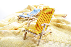 Two deck chairs on a towel Royalty Free Stock Images