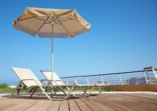 Two deck-chairs with umbrella Royalty Free Stock Photography