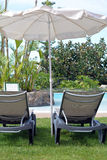 Two deck chairs under umbrella. Canary Islands.Spain.Canary Islands.Spain. Stock Photos