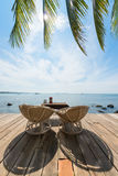 Two deck chairs on a wooden deck. Stock Image