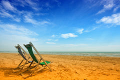 Two deckchairs on a beach Royalty Free Stock Photography