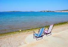 Two deckchairs on the beach in Croatia. Stock Photos