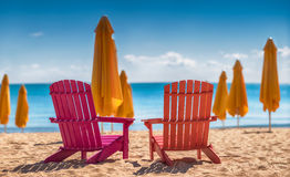 Two deckchairs on the beach Royalty Free Stock Images