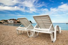Two deckchairs on a beautiful adriatic beach Royalty Free Stock Photography