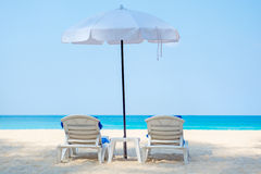 Two deckchairs on a beautiful beach Stock Images