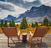 Two deckchairs beside a beautiful lake Royalty Free Stock Images