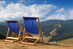 Two deckchairs in mountain Royalty Free Stock Image